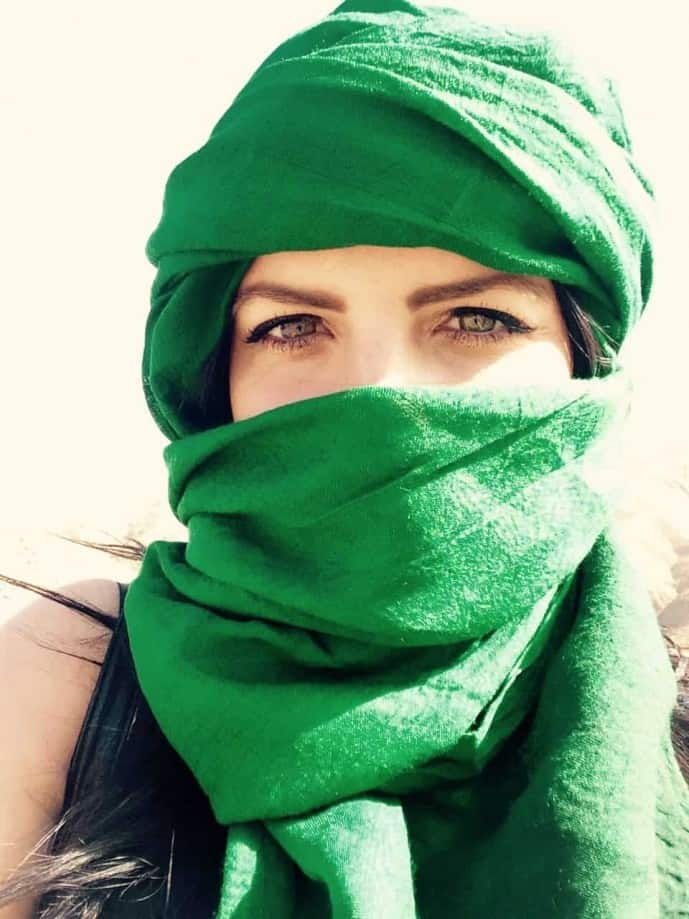 girl wearing scarf in sahara desert morocco