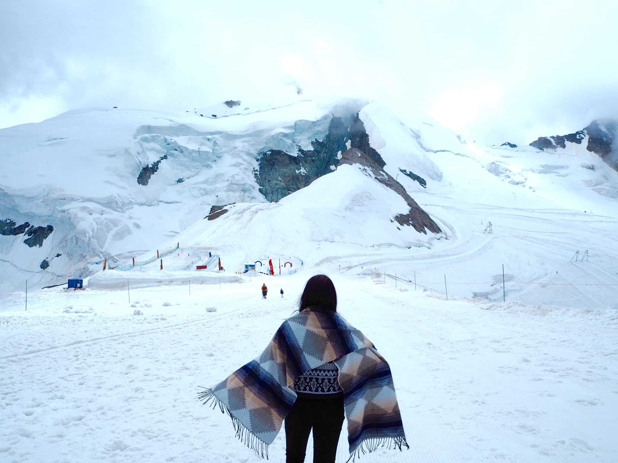 girl in the mountains of Saas-Fee ski Resort Switzerland