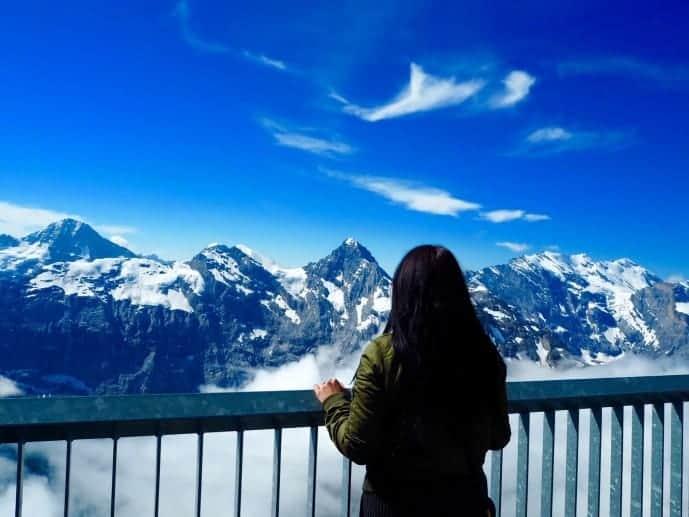 girl overlooking the mountain view of schilthorn piz gloria james bond film location 2