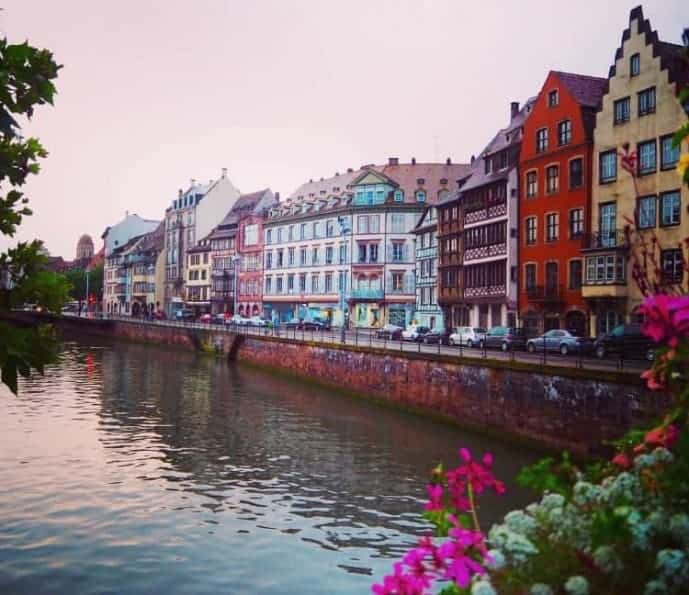 Strasbourg colourful houses over the rhine river at sunset