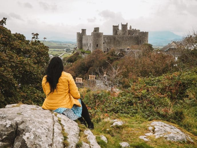 Girl looking over Harlech Castle from the viewpoint