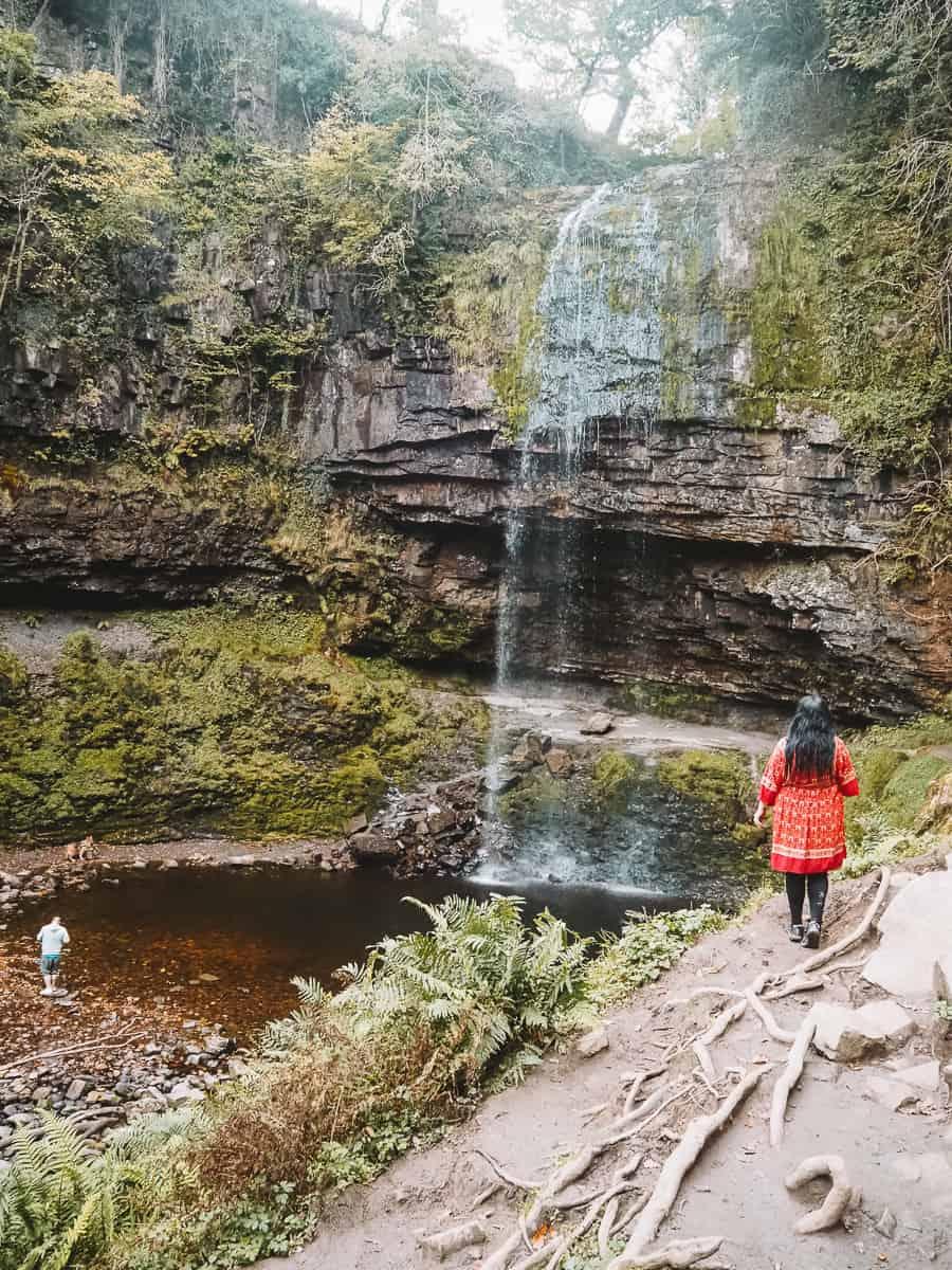 Watching the Henrhyd Falls cascade in Nant Llech