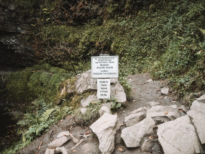National Trust warning sign at Henrhyd Falls falling rocks in the gorge