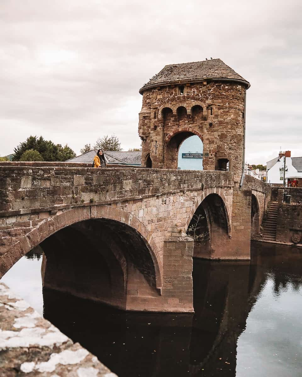 The Monnow Bridge from the bank of the River Monnow Wales