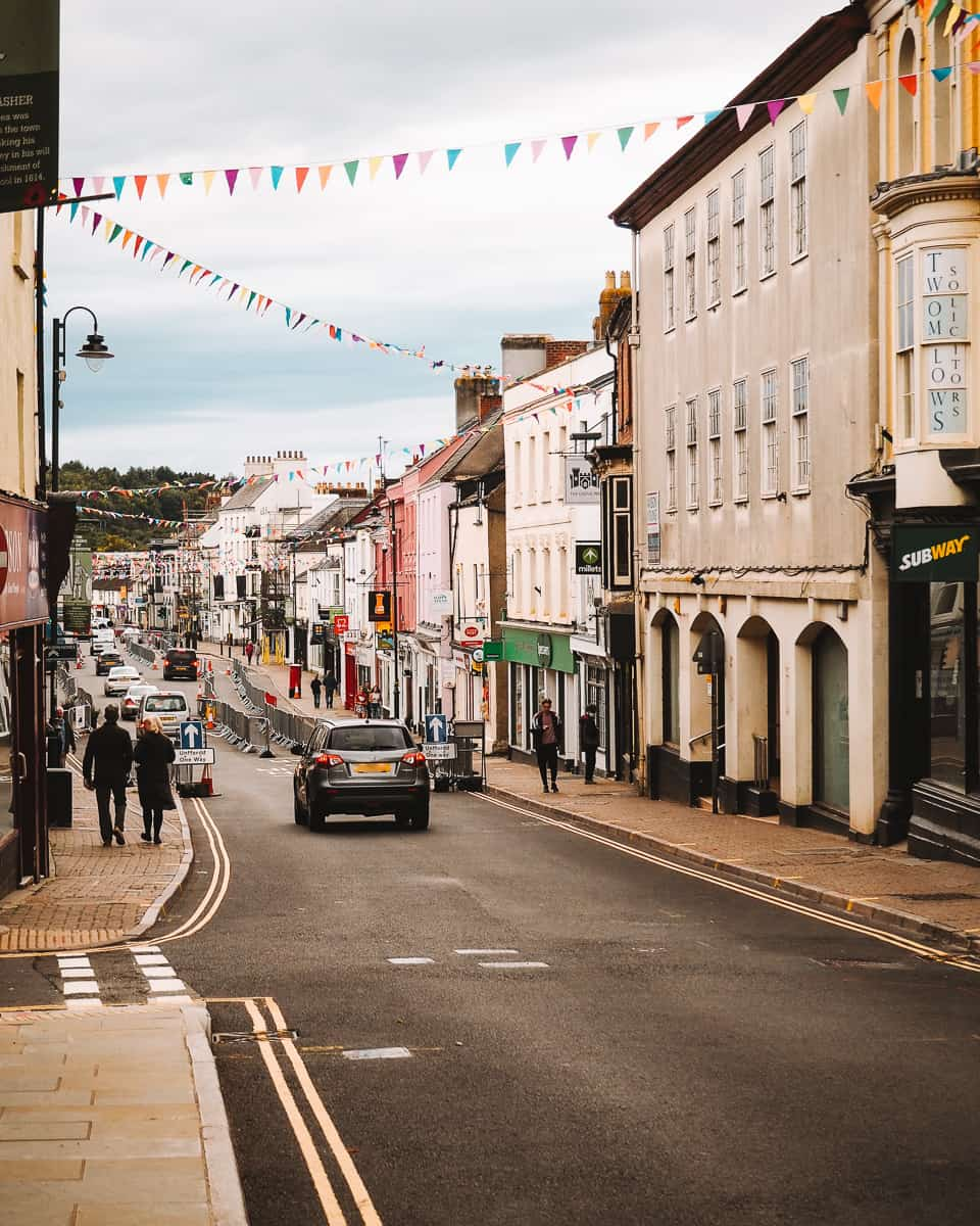 Colourful High Street in Monmouth Wales with bunting