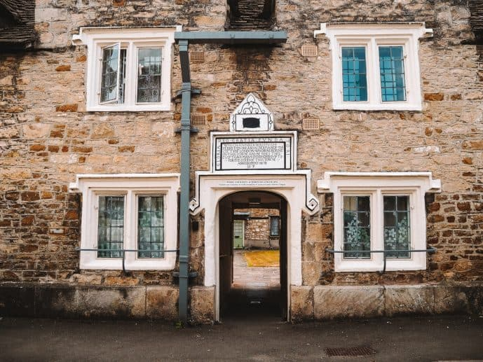 The entrance to the Perry and Dawes Almshouses on Church Street Wotton Under Edge