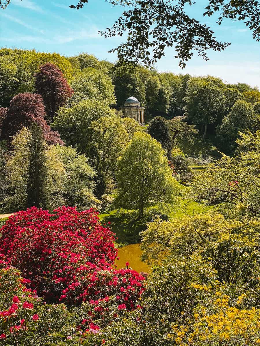 Temple pf Apollo Stourhead in Spring Rhododendrons