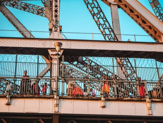 waving at locals on the Howrah Bridge