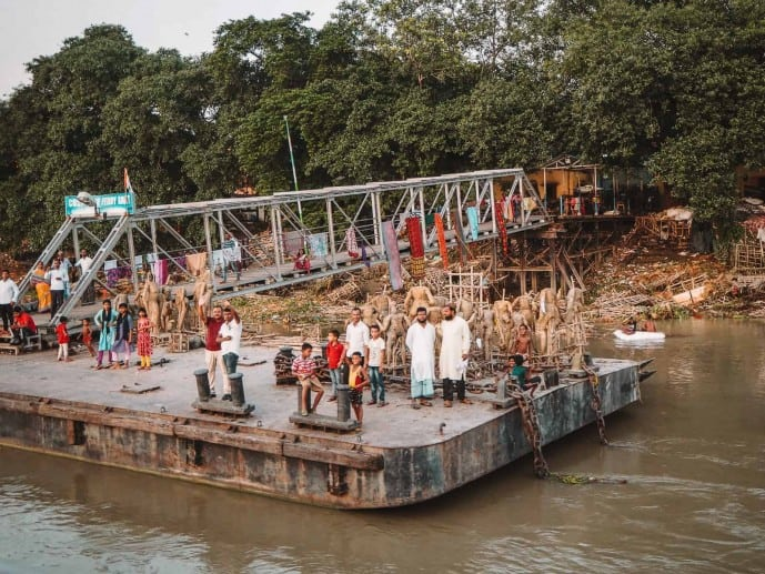 The Kali idols drying on the river!