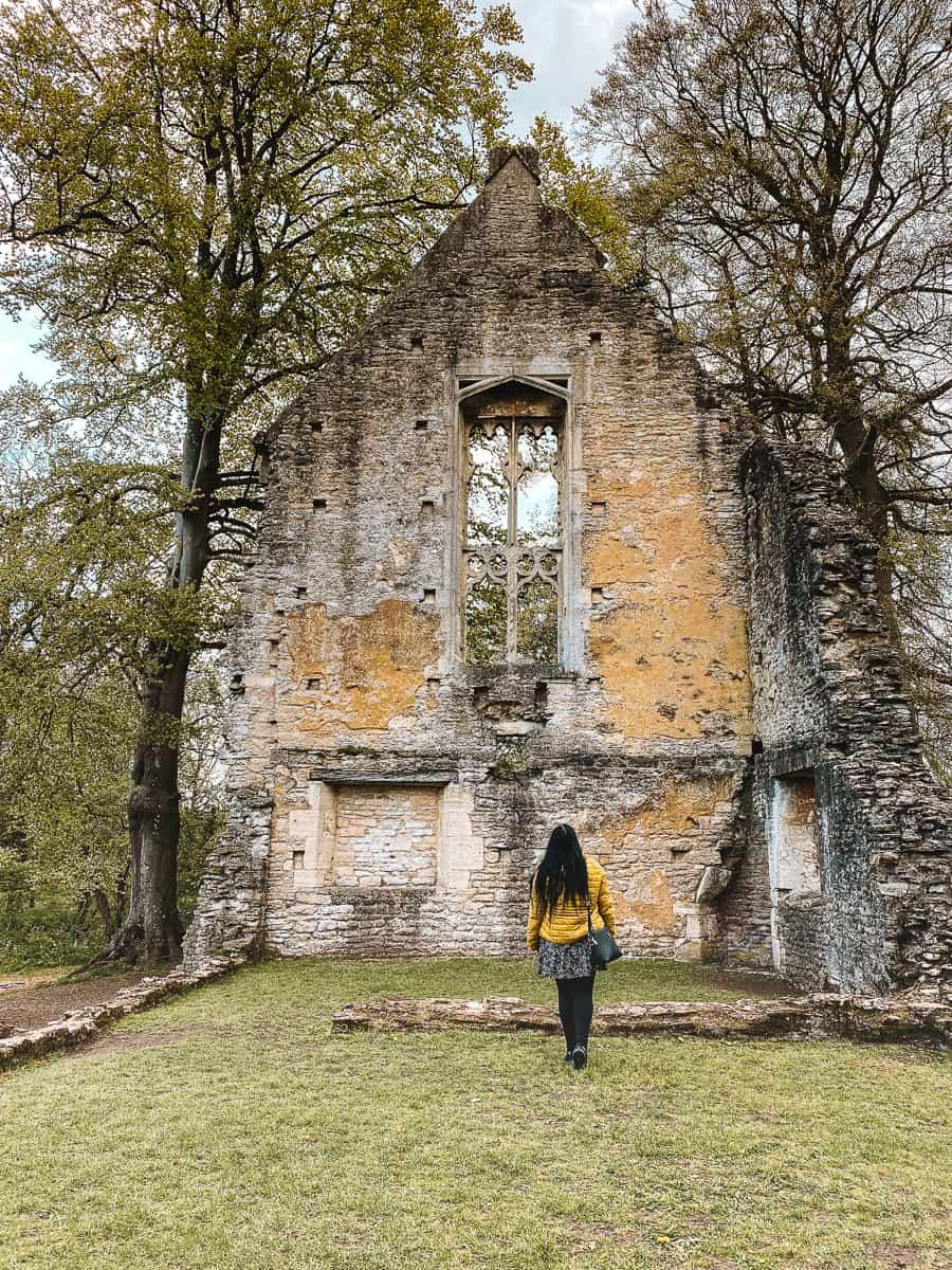 Girl in yellow coat visiting Minster Lovell Hall ruin