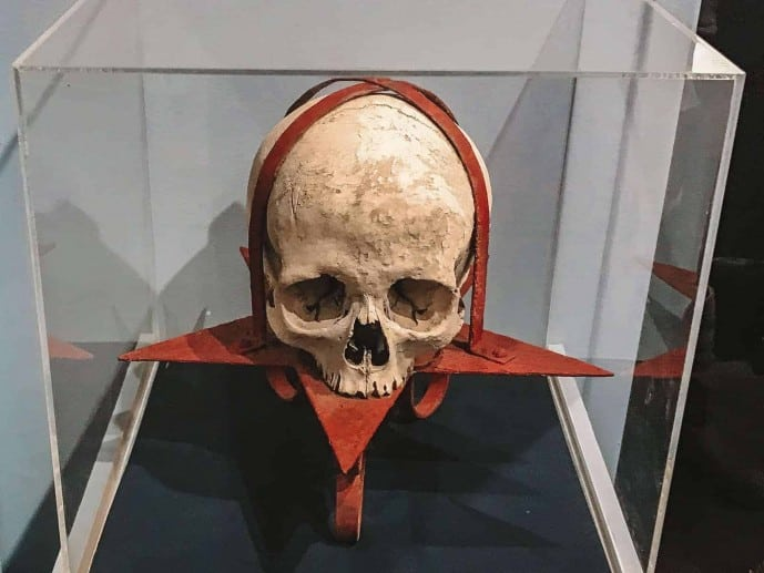 Strapped Skull to a pentacle