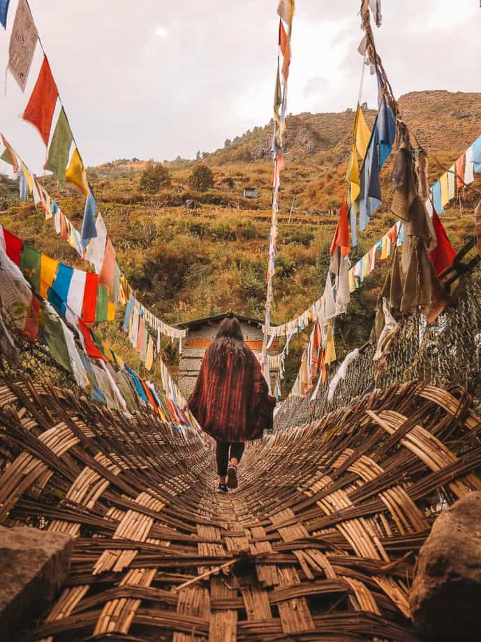 Girl crossing over Bhutanese Bridge Tawang District Arunachal Pradesh
