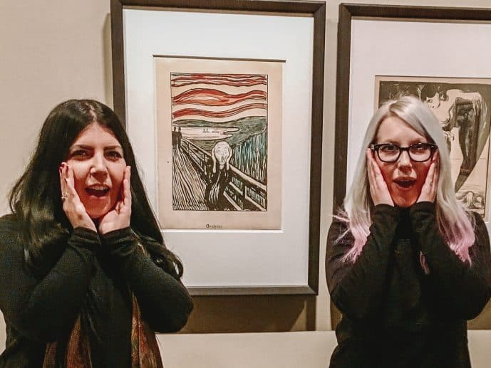 Scream Face in front of Scream Painting Munch Museum Oslo