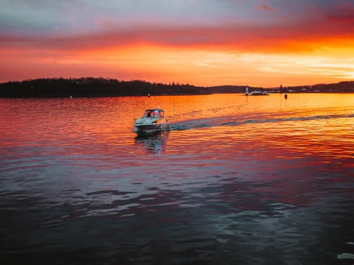 Boat in Oslofjord at Sunset in Oslo Norway