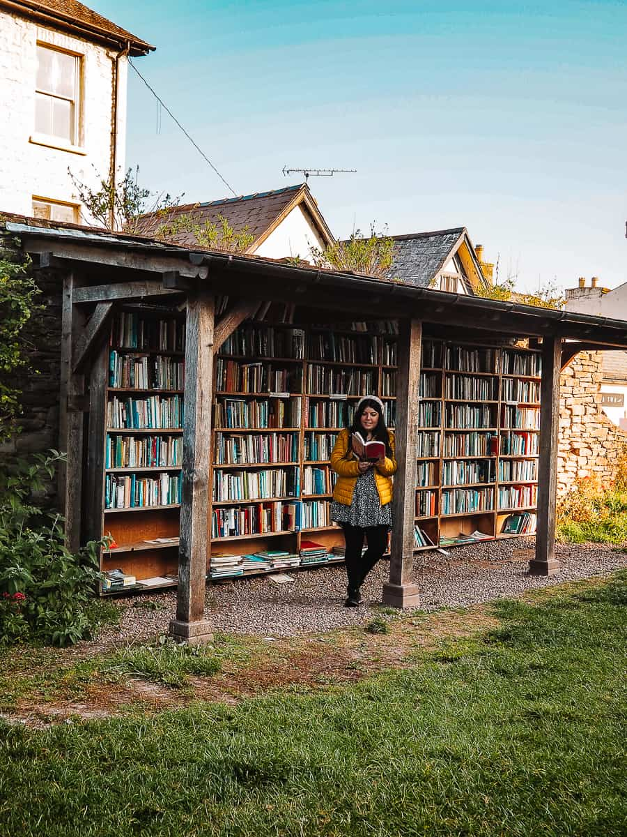 Girl reading at Hay Castle Bookshop in Hay-on-Wye Wales