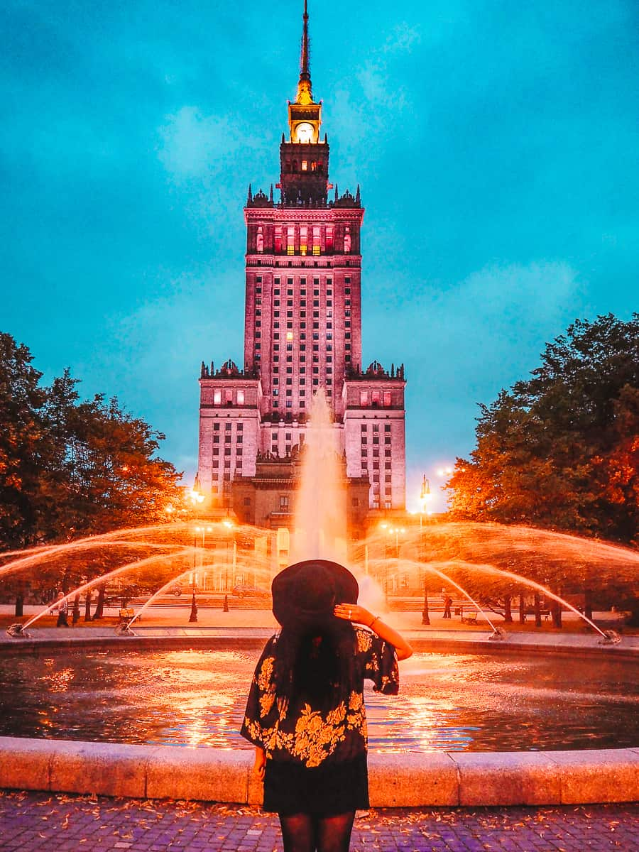 Palace of Culture and Science with fountain Lit up at Night | Instagrammable places in Warsaw