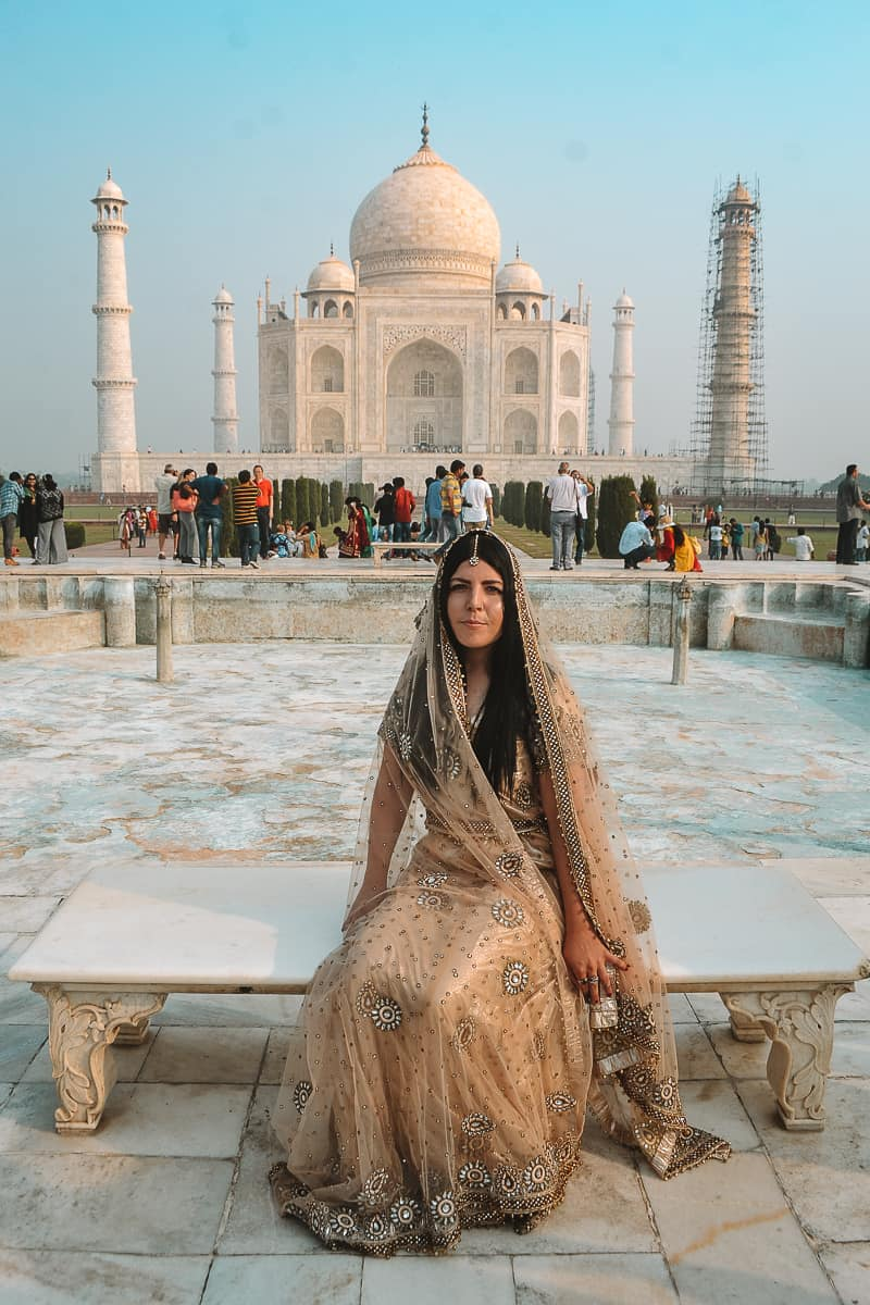 British girl in a sari Taj Mahal diana bench