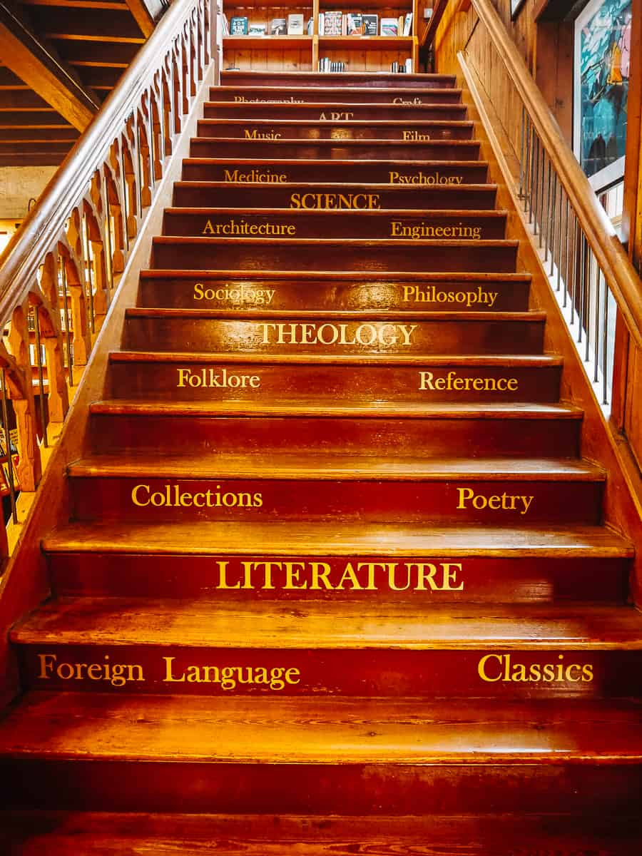 Richard Booth's Bookshop Staircase with book genres on steps