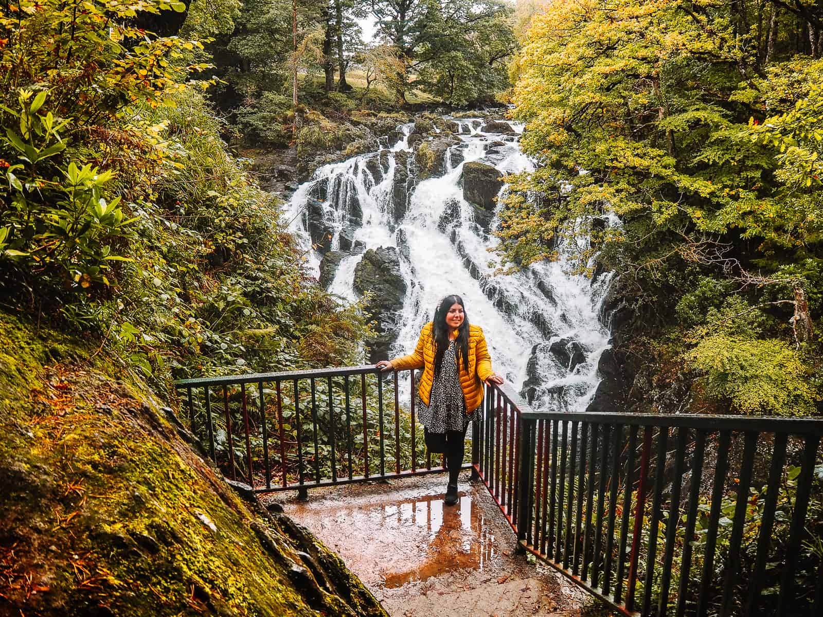 Girl on a viewing terrace of Swallow Falls Waterfall Betws-y-Coed Wales Snowdonia